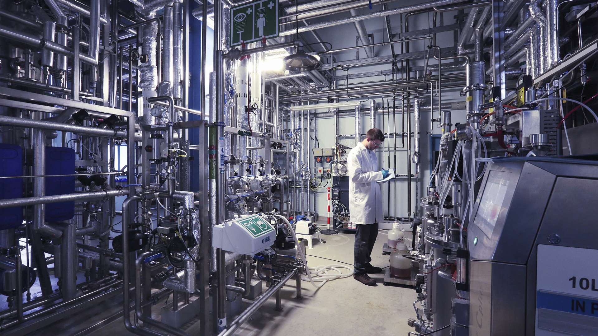 A photo of a CPI scientist working in our biorefinery facility