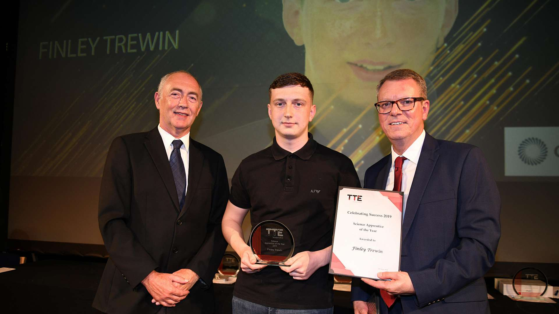 A photo of CPI apprentice Finley Trewin being presented with his award
