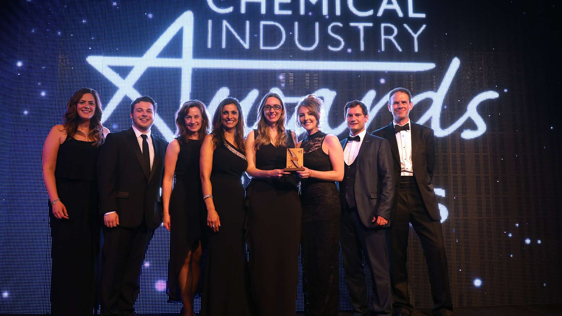 CPI's Hayley Carter, Ben Gay, Andrea Parr, Louise Barker, Sarah Scarr, Matthew Abbott and Frank Millar collect the Chemical Industry Service Provider of the Year Award from host Sameena Ali-Khan, fourth from left
