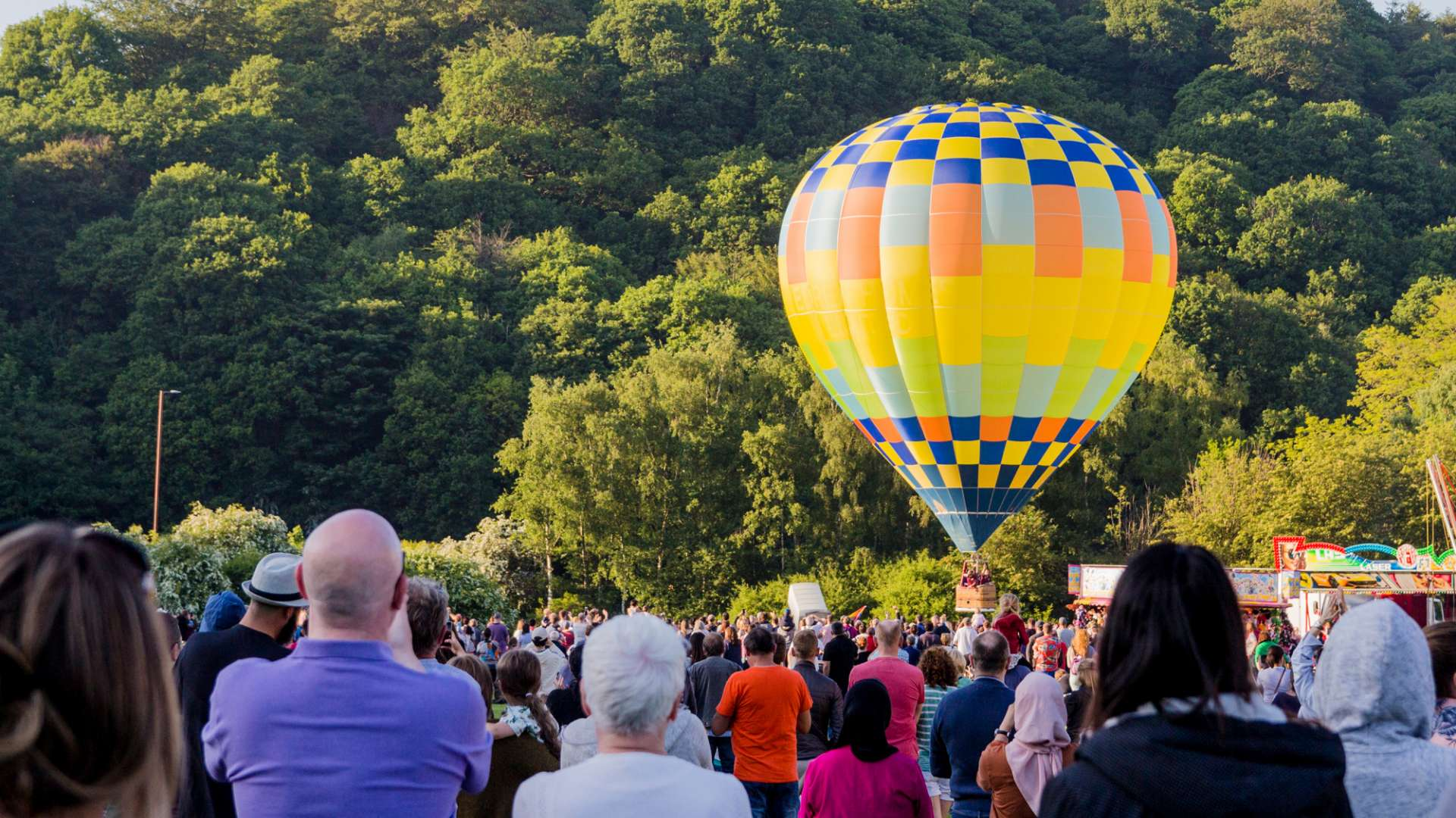 A photo of a huge crowd taking in the sights of the Durham Balloon Festival