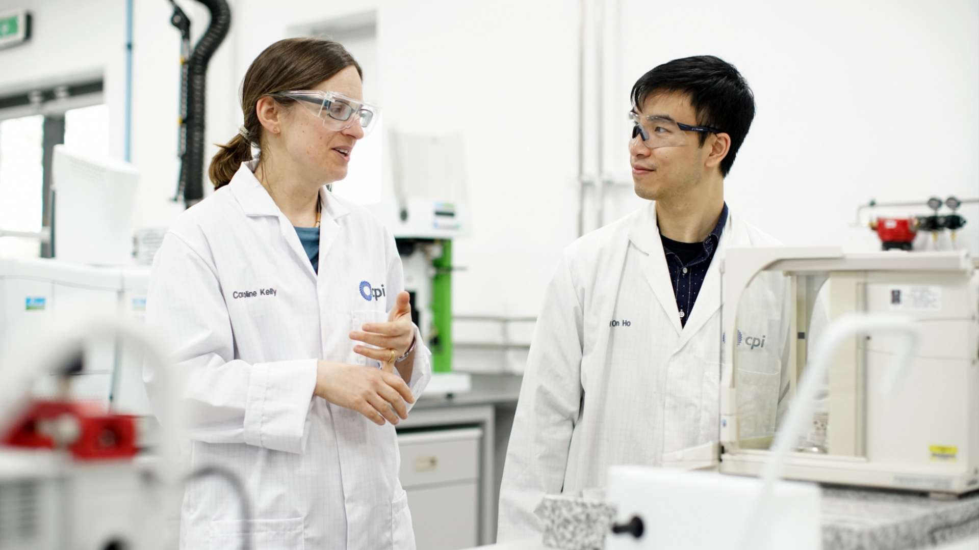 A photo of two formulation scientists collaborating in a lab