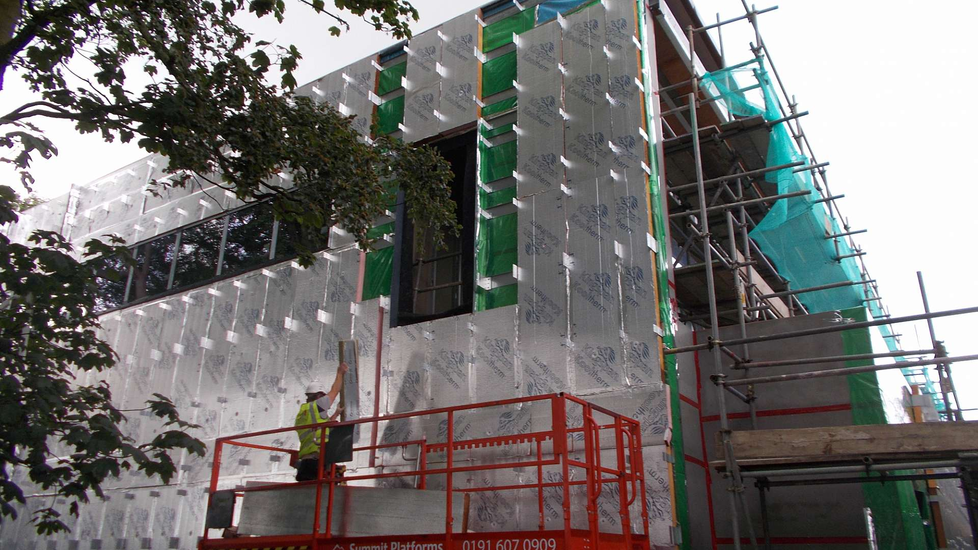 Cladding is fitted to the healthcare photonics facility