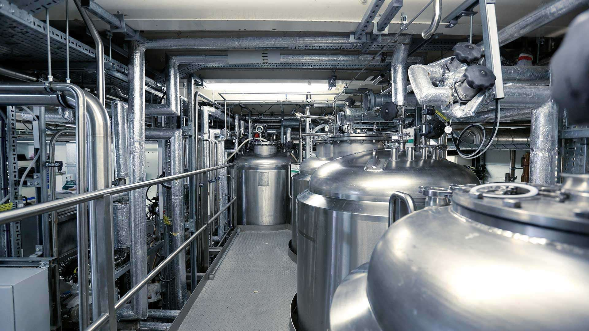 A photo of large tanks in an industrial plant